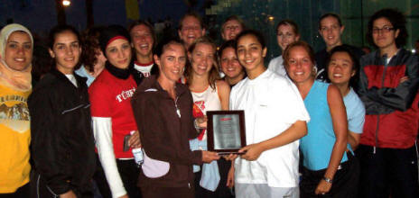Raneem El Welily, WISPA's young player of the year, receives her award from her peers ...